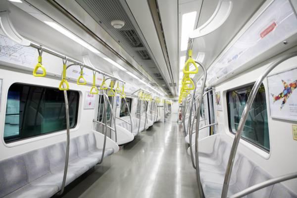 The interior of a subway car featuring Hyundai Capital ads