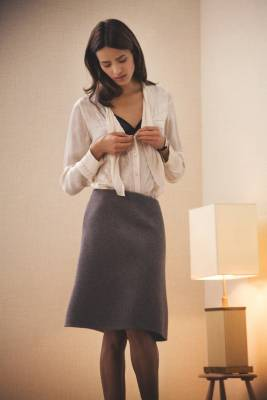 Blouse by Nicole Farhi, Bra by Eres, Skirt by Hermes, Tights by Falke, Watch by Cartier