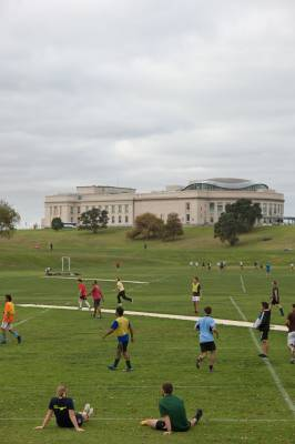 An after-work football match, with Auckland Museum in the background