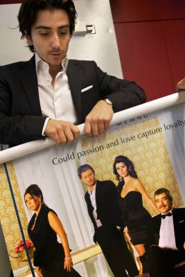 A poster for the series As¸k-ı Memnu in the Kanal Dsales and acquisitions office