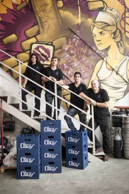 David Castro (bottom of the stairs) and his team at their Madrid brewery