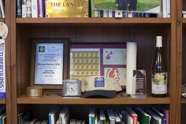 Awards and other paraphernalia on Horton's shelves