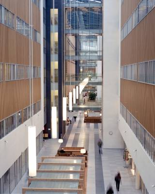 Wood-clad public atrium with hanging lights designed by CF Møller