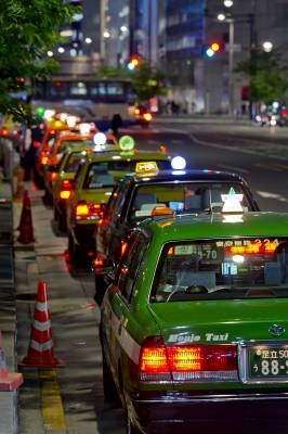 Taxicab queues snake around Shibuya Station