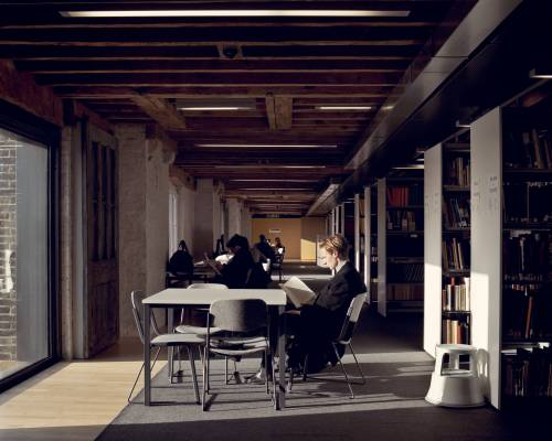 Students on the second floor library in the Granary Building