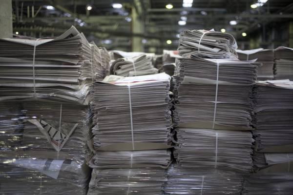 Papers at Dogan's printing press