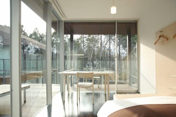 Desk in one of the 56 single rooms designed by Taiji Fujimori