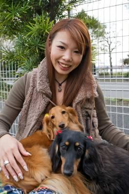 Megumi Karasawa with Bell (gold) and Niko (black tan)