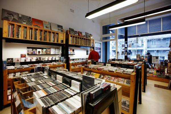 Shelves and racks of music and film neatly clutter TITLE