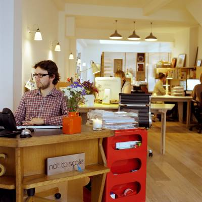 Office 4 (not to Scale, London): Scented candles, vintage furniture and lighting set the scene