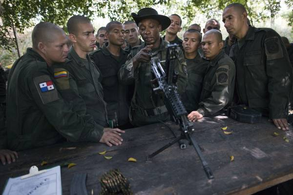 Students learn how to take apart and reassemble a machine gun