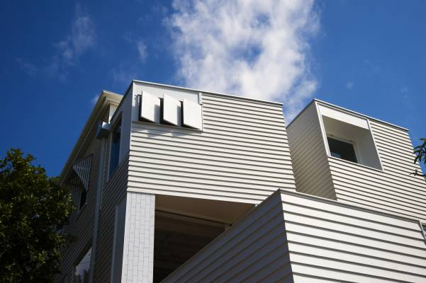 Towers with ventilation shutters and openings