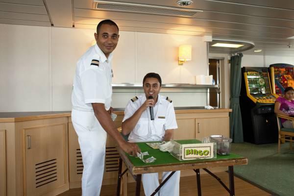 Assistant purser Merrill Joshua and purser customer care Alan Bennett run the bingo