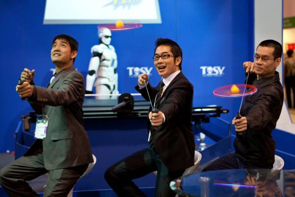 Representatives from Vietnamese company Tosy demonstrate a product