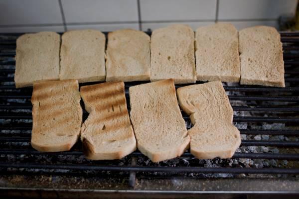 Grilling toast at Ya Kun