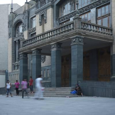 Skateboarders outside the opera house