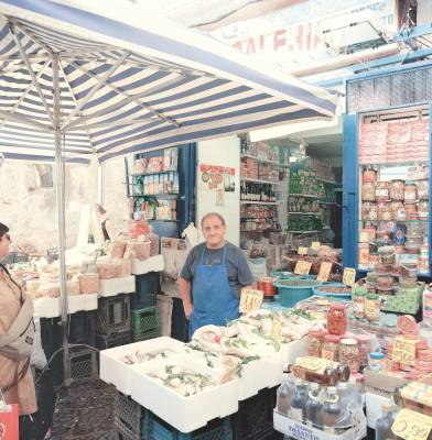 Stallholder at Antignano Market