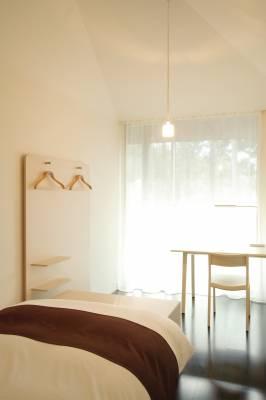 The rooms have doors opening onto wooden decks