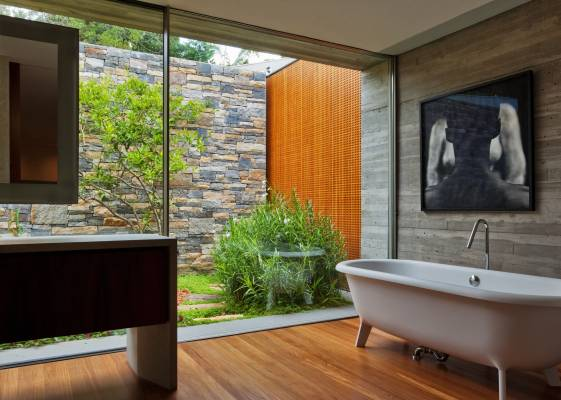 The bathtub and glass wall reveals all in the main bathroom
