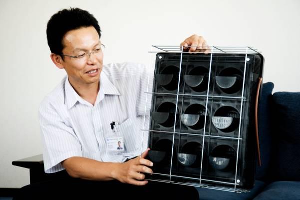 Toshiyuki Hosoya shows one of the planting units