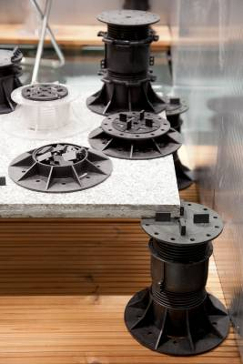 Paving pedestals for decks and raised floors