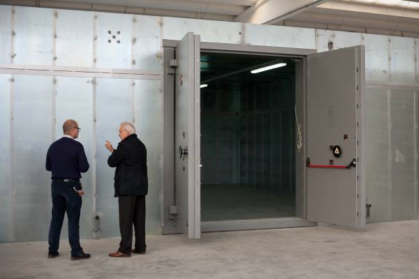 Giorgio Amedeo (right) inspects assembly of a vault on-site at a firm that stores and transports artworks in Milan