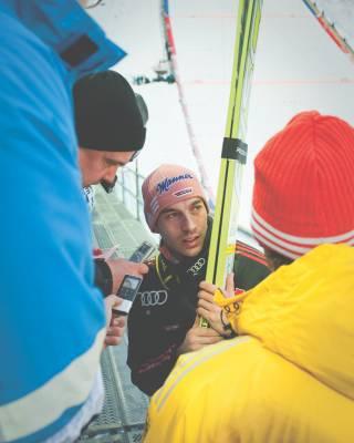 German ski jumper Michael Neumayer is interviewed by journalists