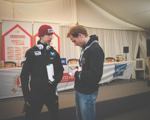 Winner of the day's competition Martin Koch (Austria) talks to Hahn