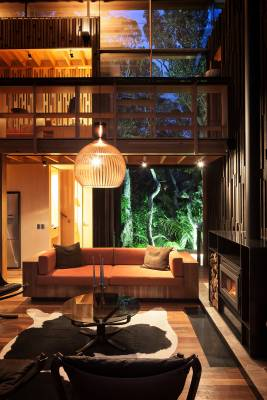 Living area overlooked by bedroom bridge connection