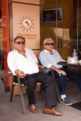 George and Morris enjoy their Sunday morning coffee in  Sassine Square