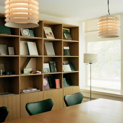 Winkreative's meeting room has Blumer Schreinerei shelving, a Novex conference table, Fritz Hansen chairs and lighting by Santa & Cole