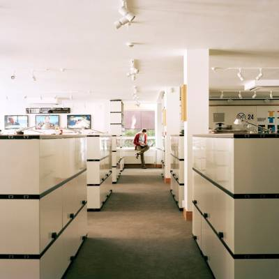 Novex shelving acts as low partions, dividing the open-plan office space into different workstations