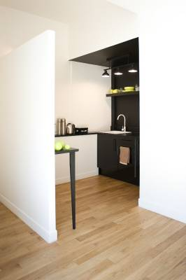 Small corner kitchen with black-stained oak surfaces