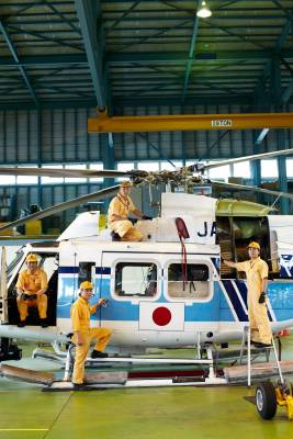 Mechanics with a Bell 412 helicopter at Hiroshima Air Station