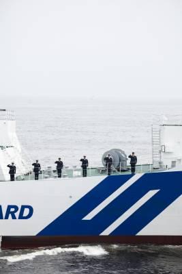A JMSDF escort ship taking part in a JCG Viewing of the Fleet