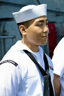 Asian-American crew members report to the flight deck to greet their Hong Kong guests