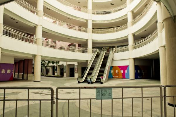 A shopping gallery at the mall lies empty