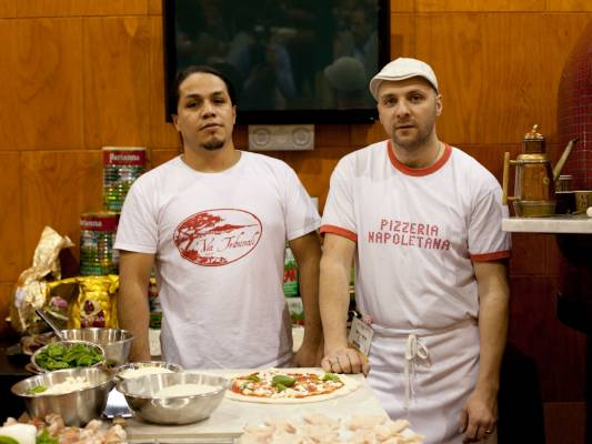 Making pizza at Via Tribunali stand