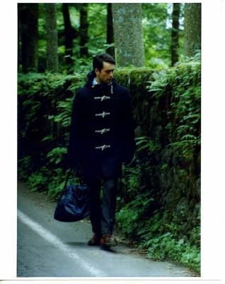 Coat by Nanamica, jumper by White Mountaineering, shirt by Dunhill, trousers by Incotex for Beams F, shoes by Nepenthes, gloves by Dunhill, bag by Prada