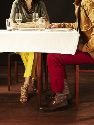 She wears: top and necklace by Brunello Cucinelli, trousers by Max Mara, shoes by Tod's He wears: jacket by Polo Ralph Lauren, trousers by Incotex, socks by Tabio, shoes by Church's