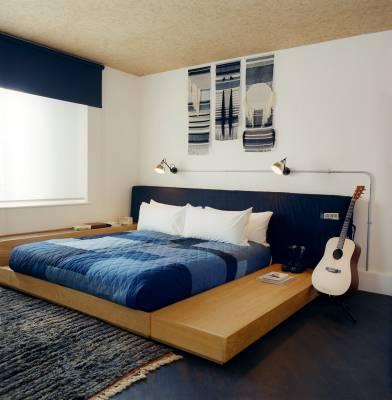Bedroom in the suite; late-night guitar strumming is optional