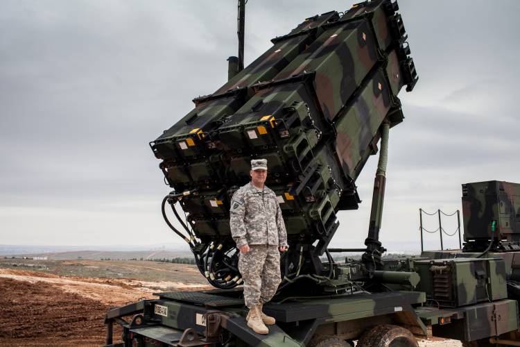 Colonel John Wanat stands in front of a PAC-3 launcher