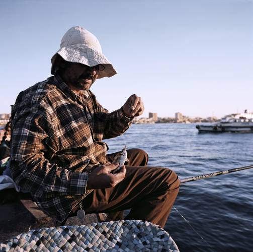 Fisherman at passenger terminal in Port Said