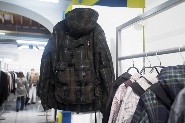 A backpack integrated into a coat at the M stand