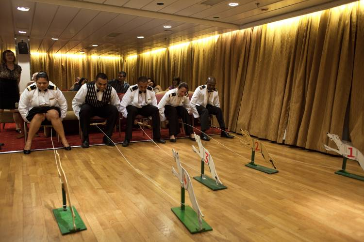 Officers play a dog-sled pulling game in the main lounge