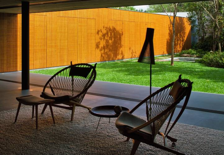 Hans Wegner Circle Chairs sit throughout the living room