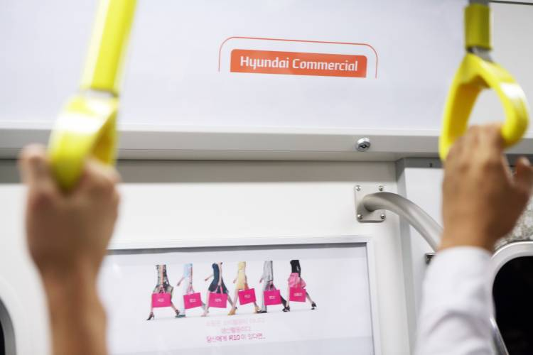 The company has signed a three-year deal to put ads on trains