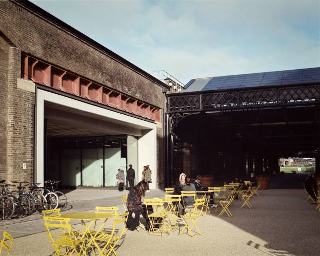 Students take a break in the sunshine outside the East Transit shed