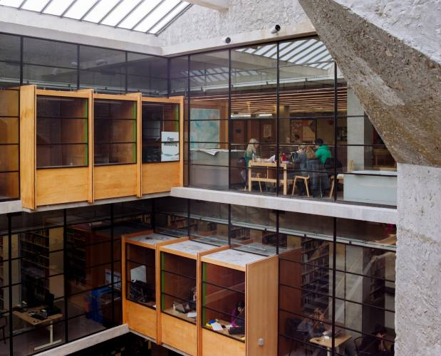Bata Library's interiors use wood and glass as a counterpoint to the concrete façade of the building