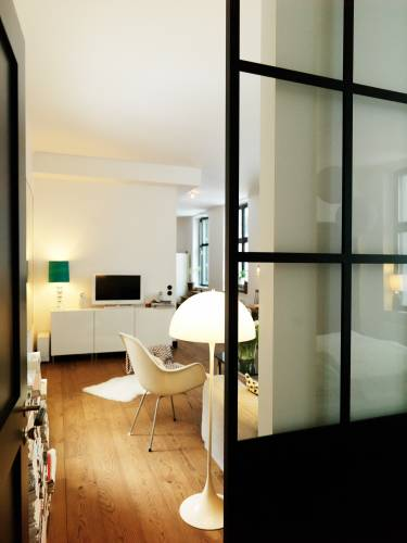 Wester's bedroom is divided from the living room by heavy Finnish sliding glass doors